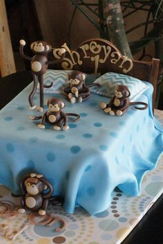 Monkeys jumping on a bed birthday cake