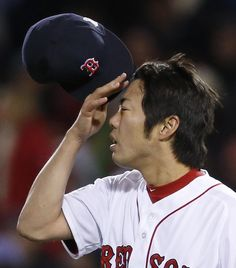 #WorldSeries2013 #Bosox #SLCardinals Boston Red Sox relief pitcher Koji Uehara rubs his forehead during the ninth inning of Game 2 of baseball's World Series against the St. Louis Cardinals Thursday, Oct. 24, 2013, in Boston. The Cardinals won 4-2 to even the series 1-1. (AP Photo/Elise Amendola)