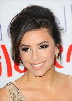 Eva Longoria Eva's elegant look is easy to recreate. Pull hair back into a chignon and let a few pieces fall free in the front.