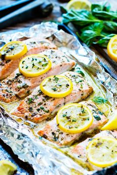 Basil & Lemon Baked Salmon in Foil Basil & lemon baked salmon in foil is a healthy salmon recipe to make that is low-carb, Paleo and a gluten-free dinner option for the whole family. This seafood recipe is a quick meal full of and healthy fats. Healthy Salmon Recipes, Easy Healthy Dinners, Quick Meals, Fish Recipes, Lunch Recipes, Easy Dinner Recipes, Seafood Recipes, Cooking Recipes, Simple Recipes