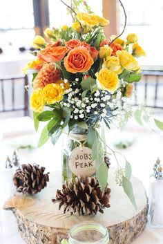 These centerpieces are from my friends wedding. The bride and groom hand made the logs and the wooden names. The brides mom did the flowers. Tiara+Nick Wedding: Centerpiece - DIY; Photography - Melina Wallisch