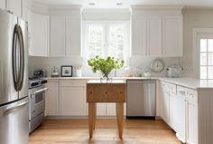 Interior Design | Kelly McGuill Home Simple clean lines, white kitchen, butcher block island, natural wood floor