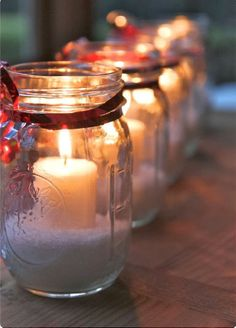 Can't get any simpler than this to create a holiday glow, outdoors and indoors: MASON JARS, EPSOM SALTS OR SUGAR, a little red RIBBON & a flickering CANDLE. Placed in a row on windowsills, on mantles, along tables or gathered around a porch entrance, the effect will be magical.