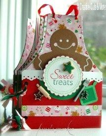 Another great idea for a cookie exchange book. [This kit will allow you to make ten aprons with pockets, perfect for holding recipe cards.   This kit contains twenty five aprons cut from chipboard,  and various colors of paper to complete the project.