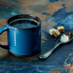 A navy blue ceramic mug with reactive glaze and brown interior. Part of the Stacking Collection.