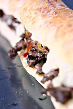 Steak Sandwiches with Caramelized Onions and Provolone Cheese from cravingsofalunatic.com- This easy recipe will be a hit with…