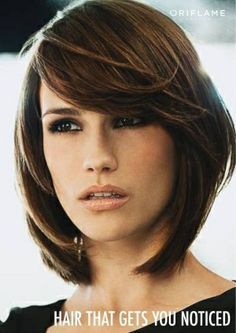 Layered bob with long side swept bangs- when I decide to cut my hair completely off again...
