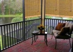 Consider a railing or flat top short wall with posts and top rail from which to hang blinds.