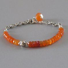 Carnelian Gemstone Solid .925 Sterling Silver Chain Bead Bracelet. $59.00, via Etsy.