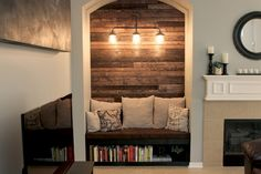 Reading Nook with Wood Plank Wall We are really excited to share our latest project. We built a reading nook with a wood wall and added extra lighting to fill up an empty and awkward space. Home Studio, Wall Niche, House, Cozy Fireplace, Home, Plank Walls, Wall Nook, Tv Nook, Grey Houses