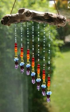 Wind chime made of colorful beads. Carillons Diy, Crafts To Make, Fun Crafts, D N Angel, Diy Wind Chimes, Driftwood Crafts, Garden Crafts, Garden Ideas, Sun Catcher