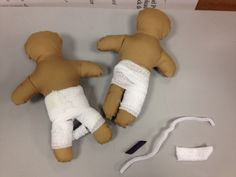 Medical Play/Prep- teaching kids about a spica cast using a macaroni noodle, gauze wrap and a pipe cleaner