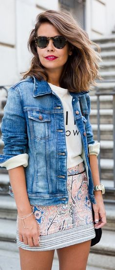 Mini skirt paired with jean jacket and graphic tee. The perfect California outfit.
