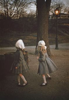 Little girls' coats, Central Park, New York City, United States, 1957, photograph by Louis Stettner.