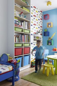 Go vertical with toy and other storage in a small kids' bedroom in an apartment. This is a great idea for rotating out toys so kids don't get tired of their playthings.