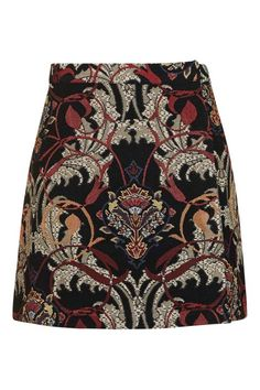 """Topshop Rambler Tapestry Skirt Don't let the cold weather make you think you have to pack up all your skirts. ELLE.com Fashion Assistant Natalie Buchanan says, """"my trick is to pair a chunky knit with sheer black tights, boots, and a good mini skirt. This jacquard version with its autumnal inspired color palette has me ready for the change in season!"""""""