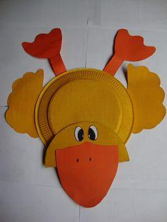 Pato elaborado con plato de cartón y cartulina naranja y amarilla, un trabajo…