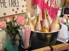 Glitter dipped champagne bottles and frozen water balloons to keep it cold. Bachelorette party decor @The Bach