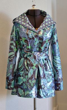 This darling raincoat is made from a pattern.  #AB043HR Amy Butler's Rainy Days Hooded Raincoat