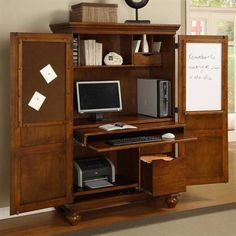 Computer desk/armoire... a neat way to hide all the junk of an office into one piece of furniture