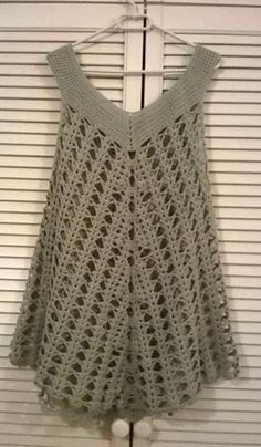 The Hanga tunic is an exclusive pattern inside the May issue of Gombolyag Magazine in Hungary. The Hanga tunic is an exclusive pattern inside the May issue of Gombolyag Magazine in Hungary. Crochet Bolero Pattern, Poncho Au Crochet, Tunic Pattern, Crochet Blouse, Crochet Patterns, Beach Crochet, Hand Crochet, Crochet Stitches, Knit Crochet