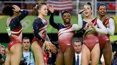 Lauren Hernandez, Madison Kocian, Simone Biles, Alexandra Raisman and Gabrielle Douglas of the United States celebrate winning the gold medal during the Artistic Gymnastics Women's Team Final Tuesday August 9.