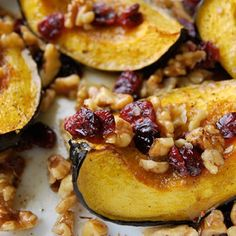An eye-catching and easy roasted acorn squash recipe with butter, walnuts and sweet cranberries.