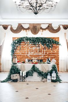 likes: the garland height above and the asymetrical framing of it.  As well as garland below.  I can see this at buffet and bar area perahaps.  Dislike: It's a bit much. (Heavy feeling)