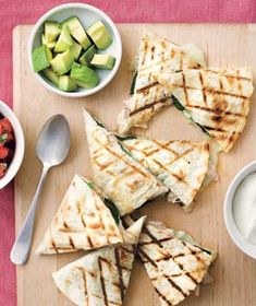 GRILLED CHICKEN & SPINACH QUESADILLAS  1  2- to 2 1/2-pound rotisserie chicken, meat shredded  4  cups  baby spinach (about 3 ounces)  1 1/2  cups  grated Monterey Jack (6 ounces)  4  large flour tortillas  1  avocado, diced  1/2  cup  store-bought fresh salsa  1/4  cup  sour cream