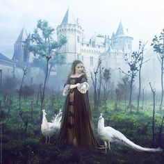 Medieval castle, woman and white peacocks.  Is this Lady Alais of Moncrieff, Ysabel's mother, in her youth?