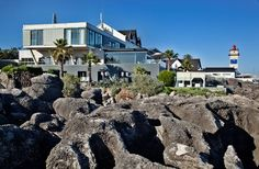 Farol Hotel in Cascais, Portugal is one of 15 Picturesque Lighthouse Hotels Around the World according to Christina Valhouli / Fodors.com - July 2015
