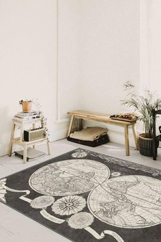 Inspired by Nicolaas Visscher's Century new world maps, this vintage-style Sailor's Map rug depicts two hemispheres with decorative borders in a sophisticated palette of graphite and pearl. New World Map, World Map Rug, Machine Washable Rugs, Decorative Borders, Natural Rug, Rug Cleaning, Home Rugs, Woven Rug, Colorful Rugs