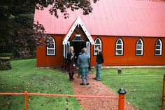| Autumnal Dalswinton Wedding. Groomsmen have a chat outside the gorgeous unique tin tabernackle church. What an amaing alternate wedding venue in Scotland this is.