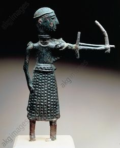 Archer wearing an oriental style skirt, bronze statue, height 15.5 cm, from Sa Costa, S. Anastasia in Sardara, Sardinia, Italy. Nuragic civilisation, 5th–8th century BC. Cagliari, Museo Archeologico Nazionale (Archaeological Museum)