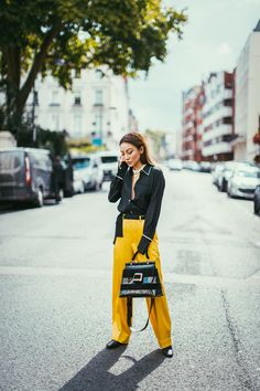 Black Satin Top with Yellow Wide Leg Pants // NotJessFashion.com // wide leg pants trend, satin fashion trend, black silk pajama shirt, yellow satin pants, top handle bag, patent leather handbag, fashion week street style, fashion week outfit, nyc fashion blogger, asian fashion blogger