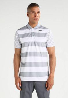 Nike Golf. STANDARD FIT - Poloshirt - wolf grey/black. Materiaal buitenlaag:100% polyester. materiaalverwerking:jersey. Totale lengte:75 cm bij maat M. patroon:gestreept. Mouwlengte:korte mouwen. Lichaamslengte model:Ons model is 188 cm groot en draagt...