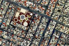 """This satellite image of Ecatepec, Mexico reminds me of abstract """"modern"""" art. grids of  squares and rectangles  is suddenly interrupted by a large patch of connected circles of varying sizes.  Earth View is a collection of the most beautiful and striking landscapes found in Google Earth."""