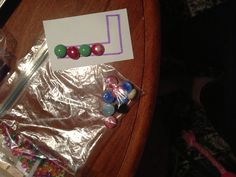 Busy bag - pre-writing - put beads inside of block letter using proper top to bottom direction (could also incorporate pattern)