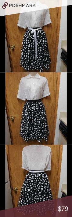Stunning Black Rockabilly Skirt W/White Dots &Belt NWOT. This skirt is really beautiful and adorable. Comfy material. Lined. Belt included. Gorgeous colors and exclusive style. Size 16W. Save $$$ on bundles. Skirts Midi