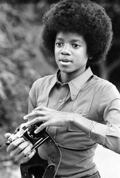 Michael Jackson with a camera