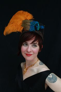 "1930s/1940s-style black felt turban with brown vintage veiling and colorful ""Bird of Paradise"" faux bird"
