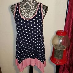 TOO CUTE!!! SUMMER TOP THIS TOP IS SO CUTE WITH A BOW IN THE BACK,  POLKA DOTS AND PEACHY/PINK TRIM.  This top had never been worn.   I washed it and never wore it. Made in the USA. Tops Tunics