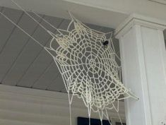 Crocheted Spider Web... little extra yarn you can stretch and pull to make a dollie in into a spider web.