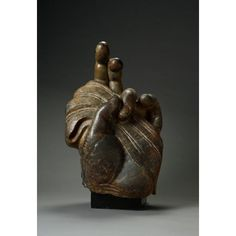 Asian Art Museum Online Collection Hand of Buddha Place of Origin: China, Xiangtangshan Historical Period: Tang dynasty (618-906) Materials: Polished grey limestone Dimensions: H. 27 in x W. 18 in x D. 12 in, H. 68.5 cm x W. 45.7 cm x D. 30.4 cm Credit Line: Transfer from the Fine Arts Museums of San Francisco, Gift of the M.H. de Young Endowment Fund Department: Chinese Art Collection: Sculpture Object Number: B69S37 On Display: No