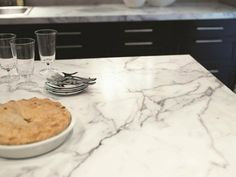 """""""Calacatta Marble"""", from Home Depot...Made by Formica, $16/sq ft...a great alternative to the real stuff"""