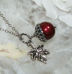 Acorn and leaf necklace via Etsy.