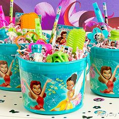Conjure up some fairy magic with Tinker Bell favor buckets the party pixies will <3! Click the pic to see all the goodies!