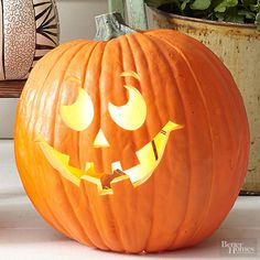 We're not sure why this pumpkin's smile is so wistful. Maybe he's remembering fond days gone by, when he was just a mini pumpkin on the vine? Or he could just be admiring the harvest moon. Whatever the case, this carved pumpk/