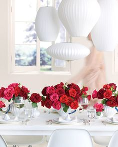 Blooms in every shade of red create a pop against an all-white tablescape