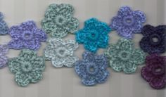 100 flower scarf pattern, how pretty!  This would look awesome in rainbow colors!